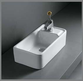 Aflang porcelænshåndvask til montering på bord.